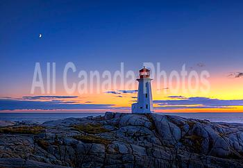 Sunset over lighthouse, Peggy?s Cove, Nova Scotia, Canada