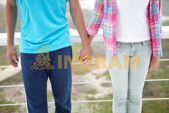 Teenage girl and boy holding hands