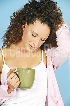 Studio image of Girl with green coffee mug.