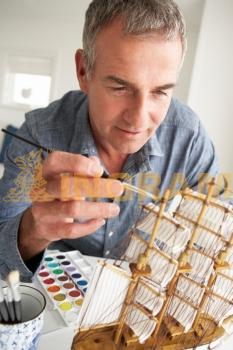 Mid age man model making