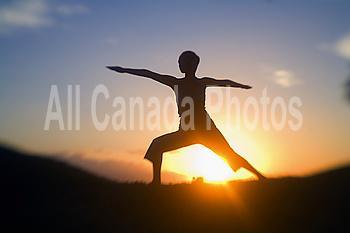 Hawaii, Maui, Olowalu, woman doing yoga at sunset.