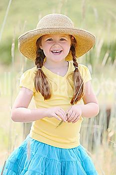 a girl wearing a straw hat; troutdale, oregon, united states of america